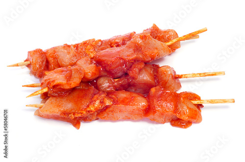 raw spiced chicken meat skewers