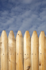 A wooden picket fence