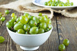 Green gooseberries in a white bowl