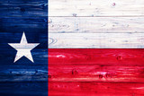 Flag of Texas on wooden surface