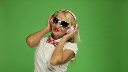 Beautiful blond woman listening to music