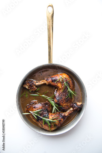 Chicken in pan on white background