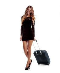 Ragazza in viaggio con valigia