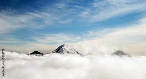 peaks of mountains above the clouds, Russia, Kamchatka - 58049111