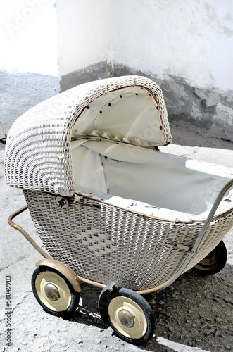 The picture shows antique, wicker stroller.