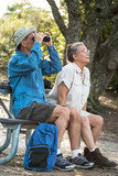 Senior Couple Hiking, Birdwatching and Camping poster