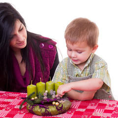 young women with a little boy with advent wreath