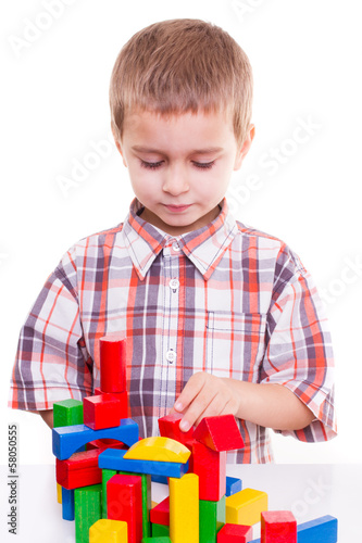 cute preschool boy play colorful wood block