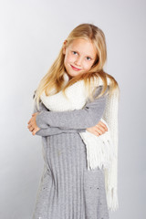 Winter portrait of  little girl wearing warm  clothes. studio