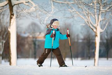 Cute little boy skiing on cross