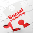 Marketing concept: Social Marketing on puzzle background