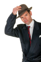 Fifties retro man raises trilby hat, on white