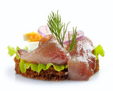 brown bread sandwich with anchovies