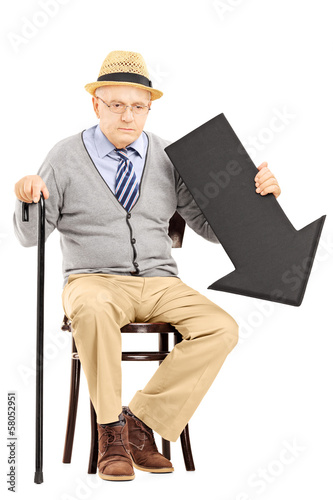 Sad senior man sitting on bench with black arrow pointing down