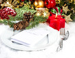 festive christmas table place setting with red and gold decor