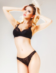 beautiful woman with perfect body dressed black lingerie