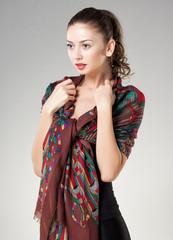 beautiful woman wearing kashmir scarf isolated on grey
