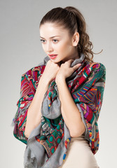 beautiful woman wearing kashmir scarf isolated on grey