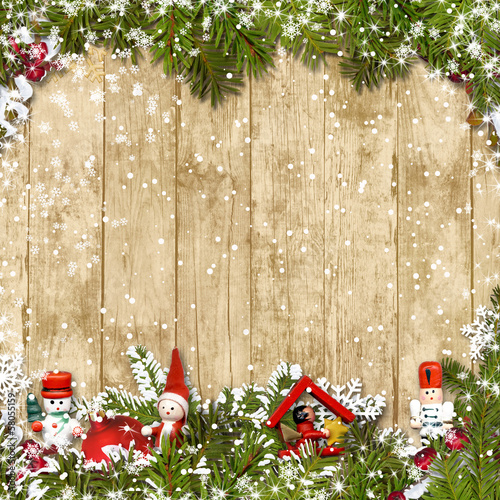 Christmas background with a border of fir branches and decoratio