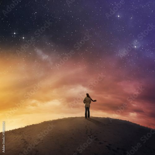 Woman under night sky.