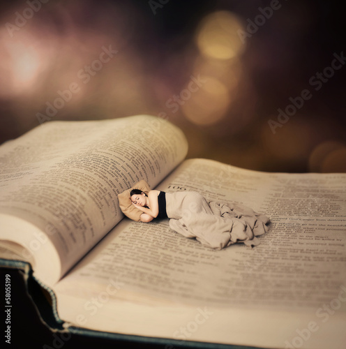 Woman sleeping on Bible.