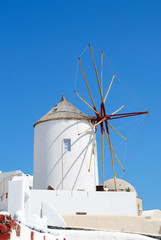Old windmill in Oia village (Santorini island, Greece)