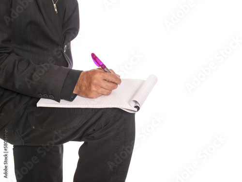 businessman with a writing block