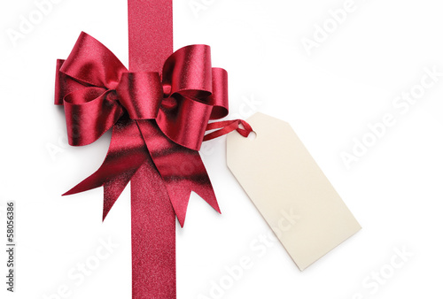 Red ribbon bow with blank gift tag