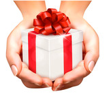 Fototapety Holiday background with hands holding gift boxes. Concept of giv