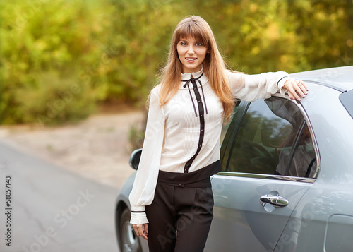 business travel: busy businesswoman with car
