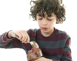 Child eating chocolate icecream