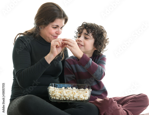 Single mom and son eating popcorn