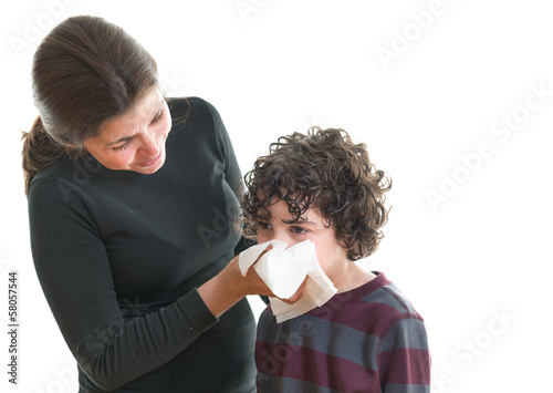 Mother helping son in sickness
