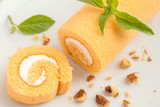Orange cake roll on a plate