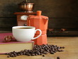 Still life of coffee beans and coffee maker, cup of espresso