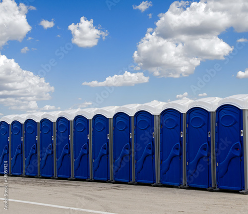 A row of blue portable toilets