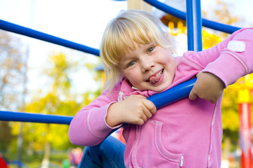 Portrait of playful six-year girl in the playground