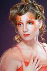 woman with orange artistic visage