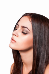Beautiful brunette woman close up long healthy hair