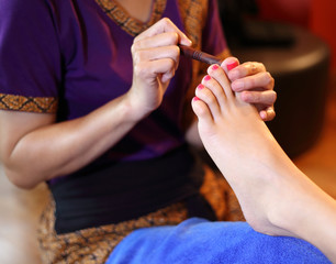 reflexology foot massage, spa foot treatment by wood stick,Thail