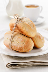 Breakfast - wheat baguettes with coffee and milk