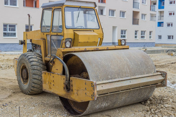 Yellow road roller in the new residential area 2