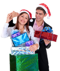 young man giving a gift a girl in Christmas