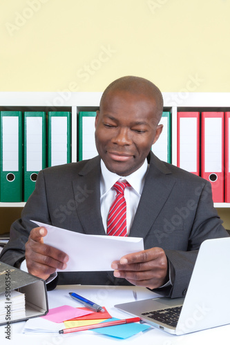 African businessman reading a message