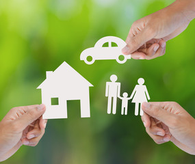 Hand holding a paper home, car, family, insurance concept