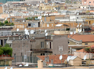 roofs of the metropolis with lots of antennas and antenna for re