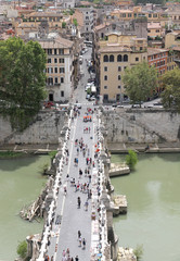 Tiber River and Saint Angel Bridge and many people