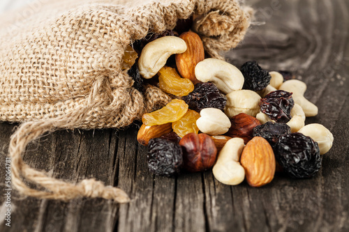 Nuts and dried fruits on wooden background