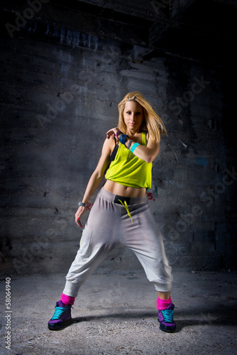 Woman posing in dark urban environment - 58064940