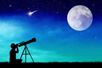 Man looks into the telescope